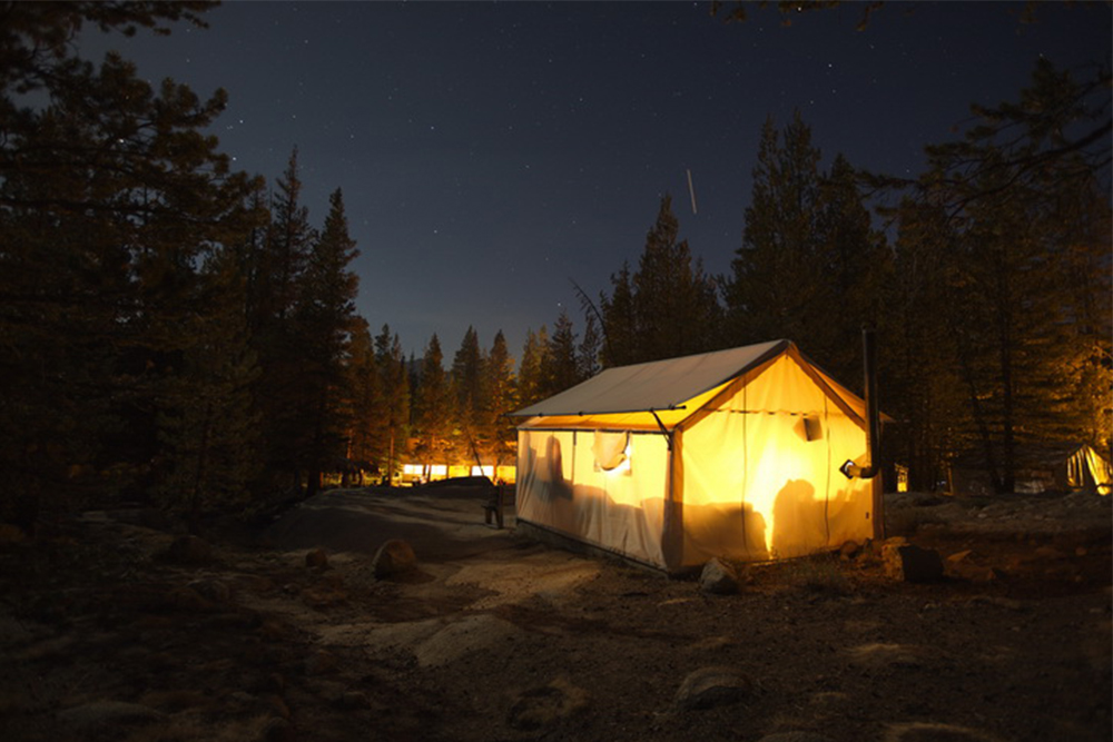 Tent cabins under a starry Yosemite sky