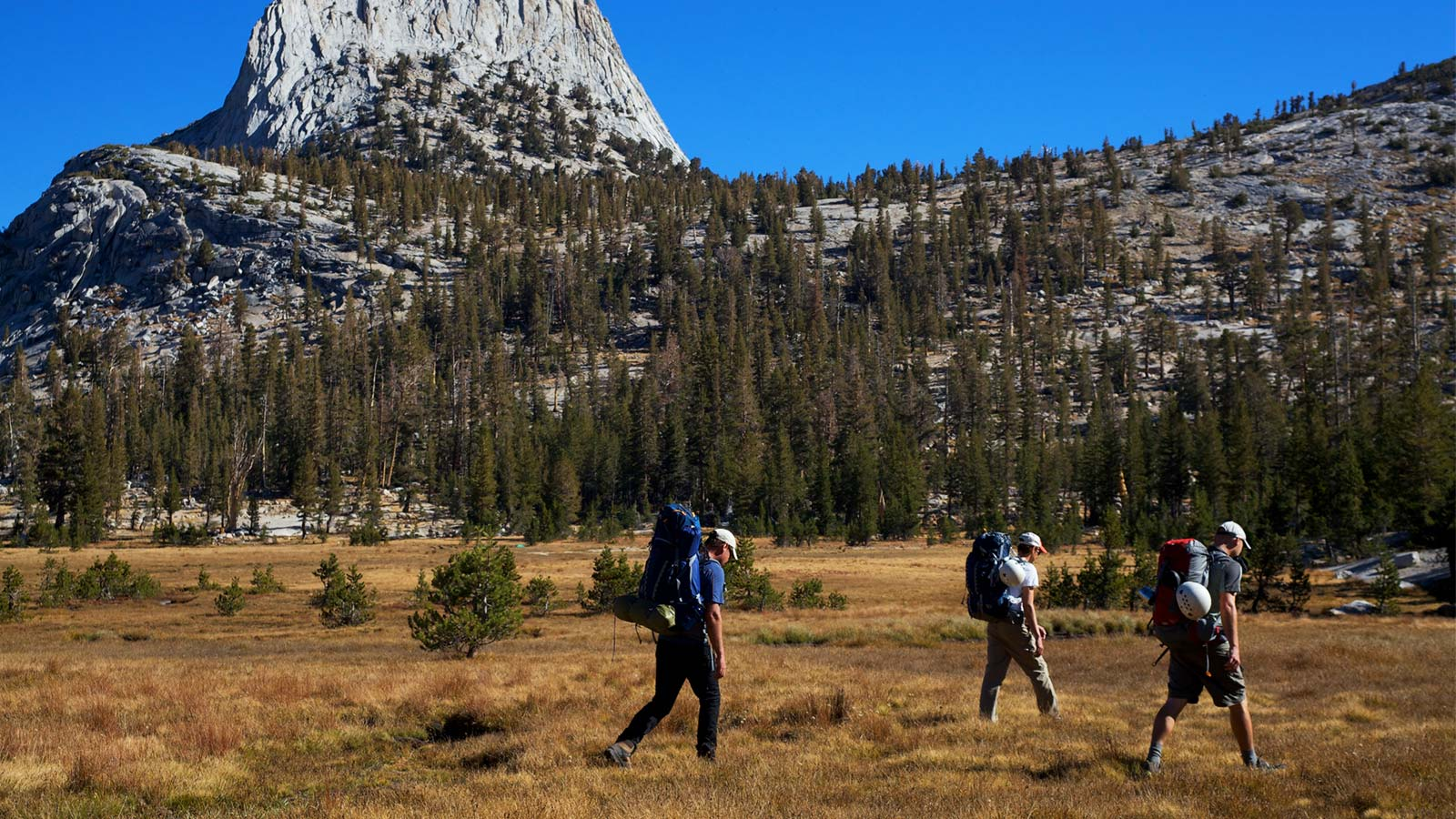 Climbers approaching Cathedral Peak