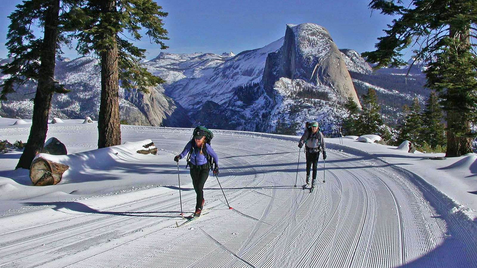 Cross-country skiers enjoying the 10.5 mile trek from Glacier Point